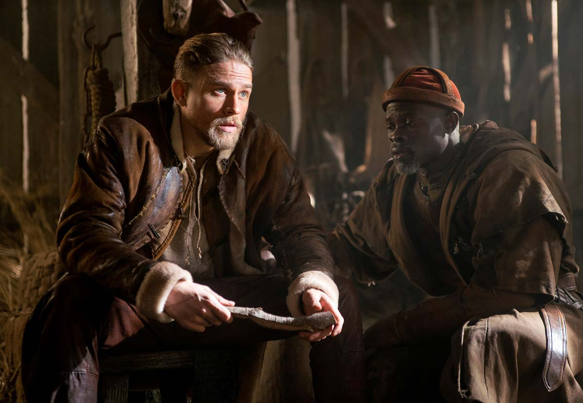 chris-raphael-sony-alpha-7RII-2-actors-in-costume-sit-in-a-dimly-lit-barn