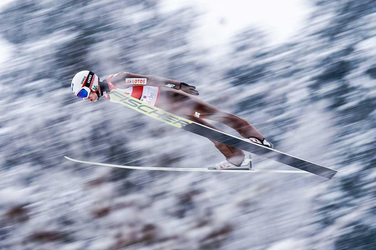 tomasz-markowski-sony-alpha-9-ski-jumper-leans-forward-as-he-flies-through-the-air